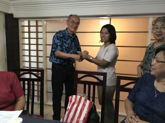 Ma Sa Nyein San accepting MEHS Foundation scholarship award from Dennis Tan
